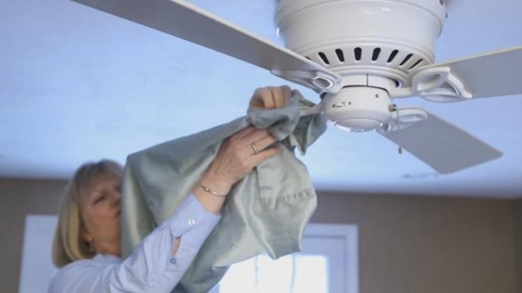 Use a pillowcase to clean ceiling fan blades