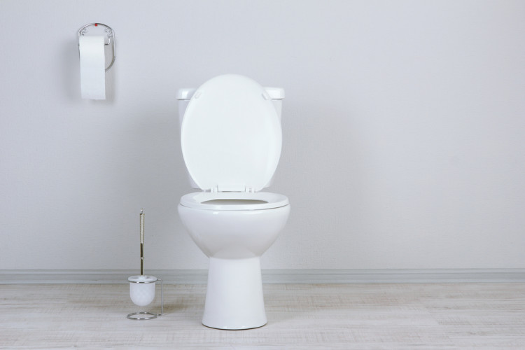 Why you should leave the toilet seat down according to science.