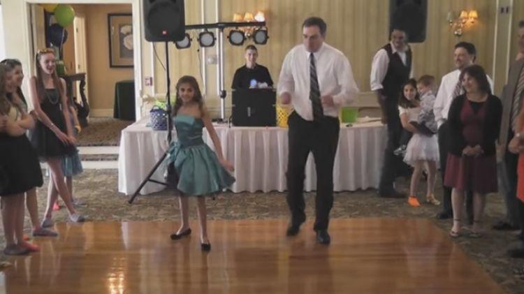 Father-daughter bat mitzvah dance.