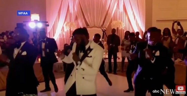 Groomsmen perform the finished dance.