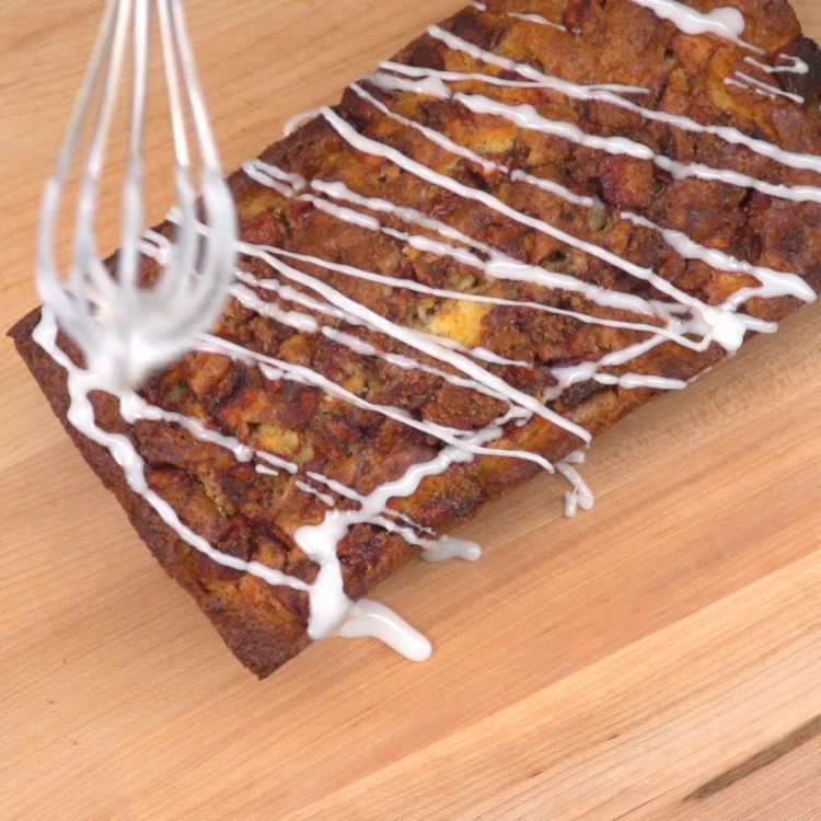 Drizzle frosting glaze on apple fritter bread