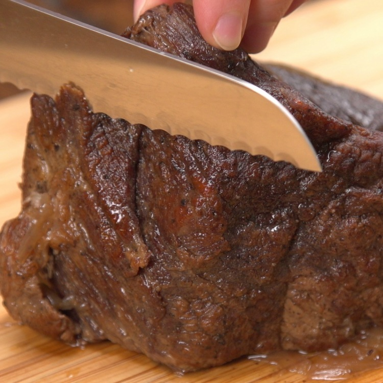 Slice slow-cooked chuck roast into thin pieces