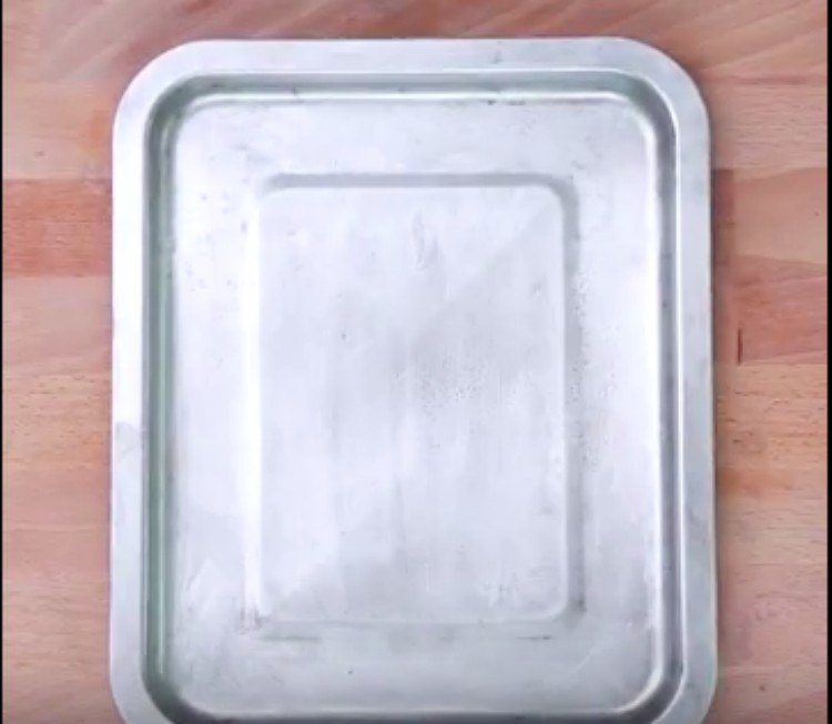 clean silver pan on wood background