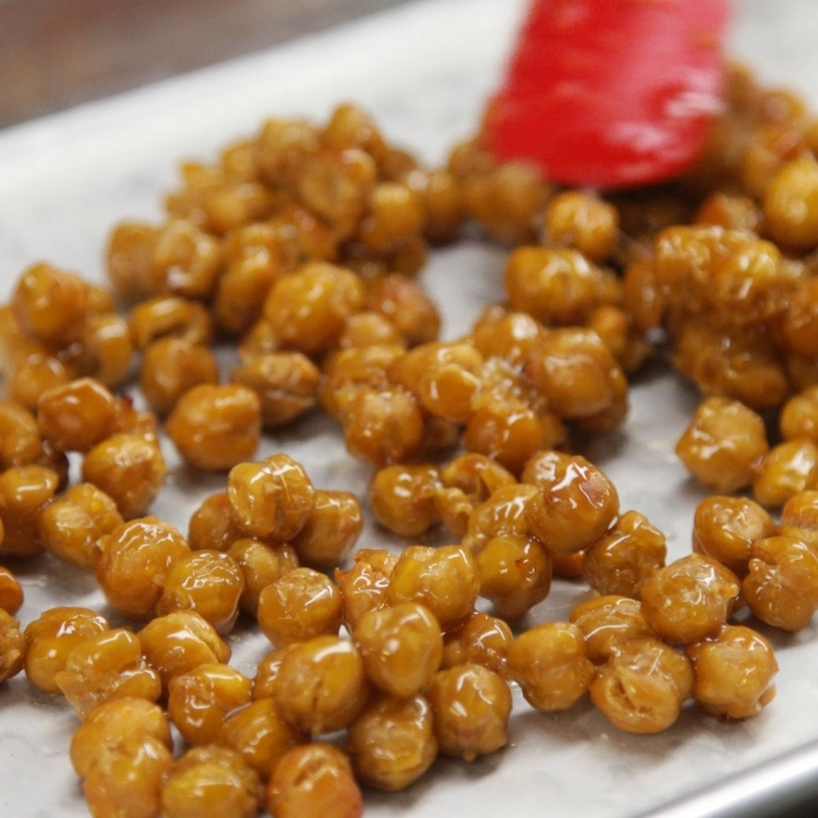 Caramelize honey coated chickpeas by baking again for 10 more minutes