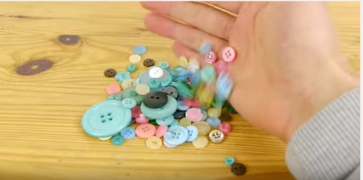 person displaying an assortment of buttons