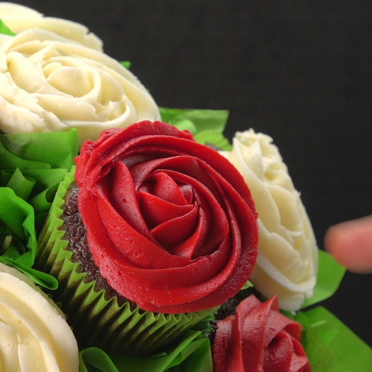 Close-up of cupcake roses and tissue paper leaves