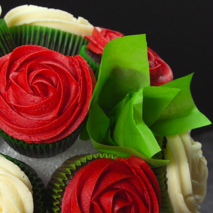Take a bunched piece of tissue paper and stick it to the exposed Styrofoam in between the cupcakes.