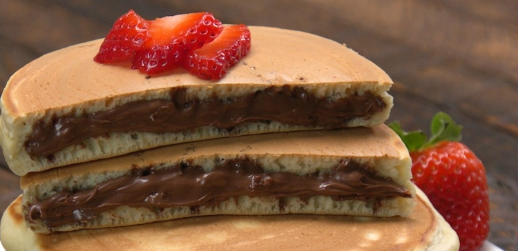 Close-up of 2 Nutella-Stuffed Pancakes sliced in half