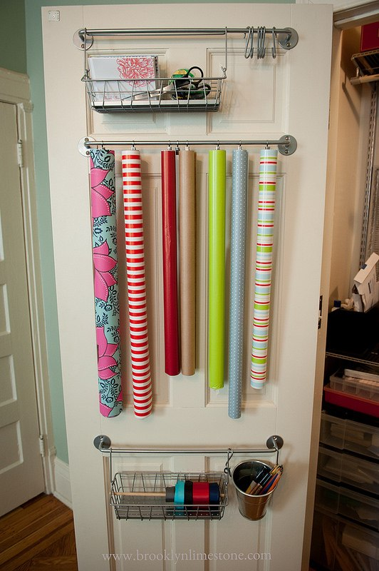 Gift wrap organized on towel bar.
