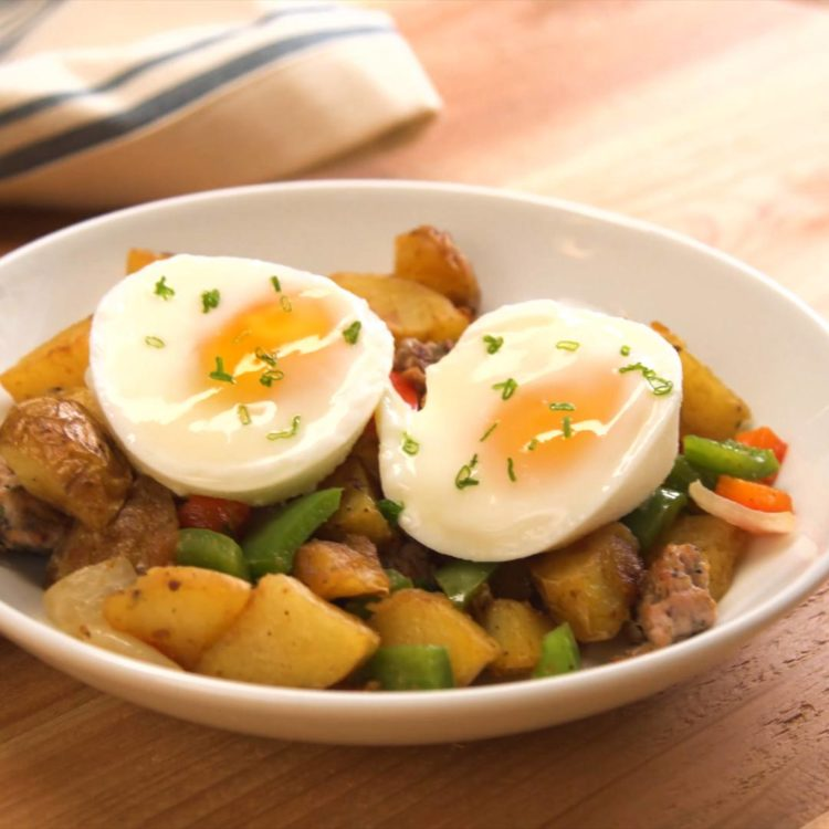 Muffin Tin Poached Eggs on top of a potato hash