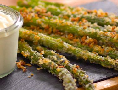 """We don't often say """"Once you start, you can't stop"""" about eating asparagus, but our crispy garlic & Parmesan-crusted asparagus is as addictive as potato chips."""