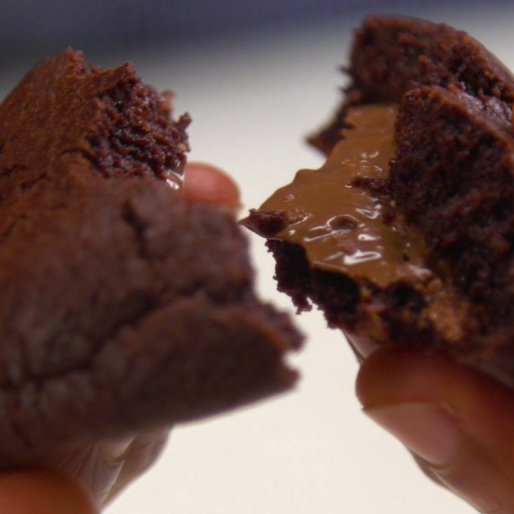 Pull apart one of these ooey gooey double-chocolate cookies and watch how it gushes melty Nutella just like a mini lava cake.