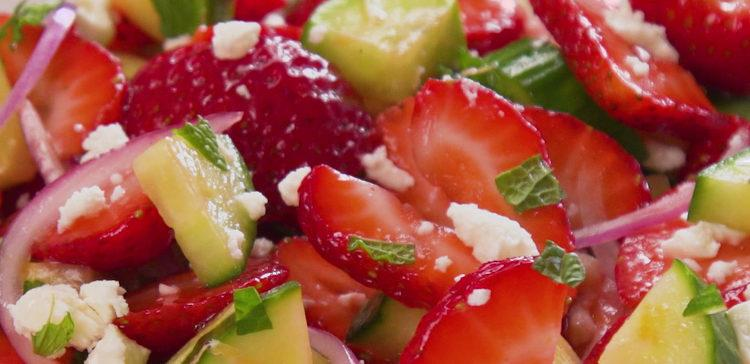 Fresh and easy summer salad with ripe strawberries, cucumbers, mint, red onions, and feta cheese tossed with a delicious homemade honey lemon salad dressing.
