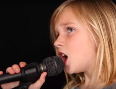 Image of little girl singing.