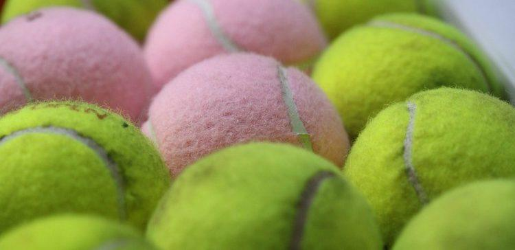 Image of arranged tennis balls.