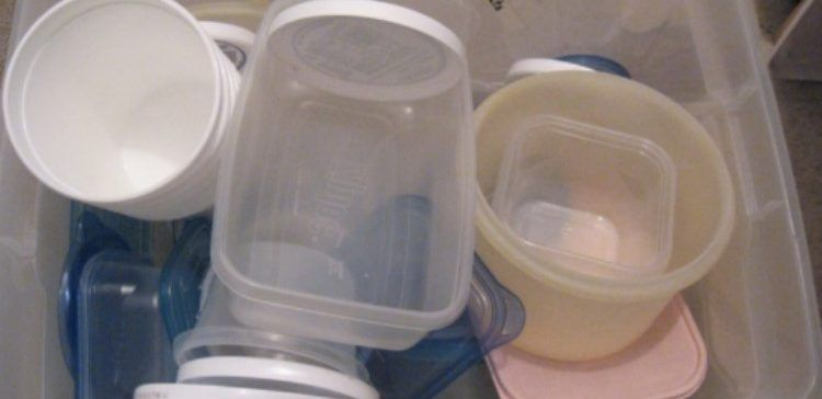 tupperware in plastic bin
