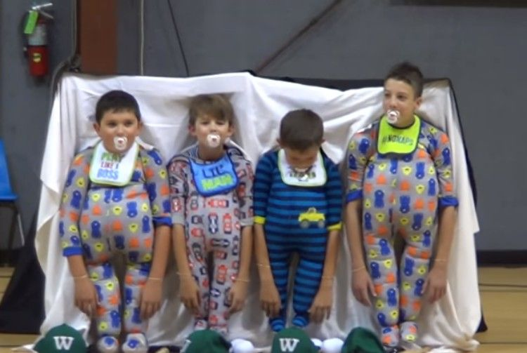 Boys in baby costumes.