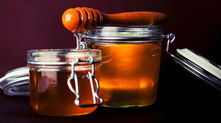 sticky honey comb over jars