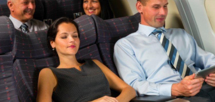 business travelers relax on plane