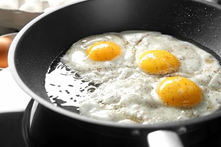 Image of sunny-side up eggs in pan.