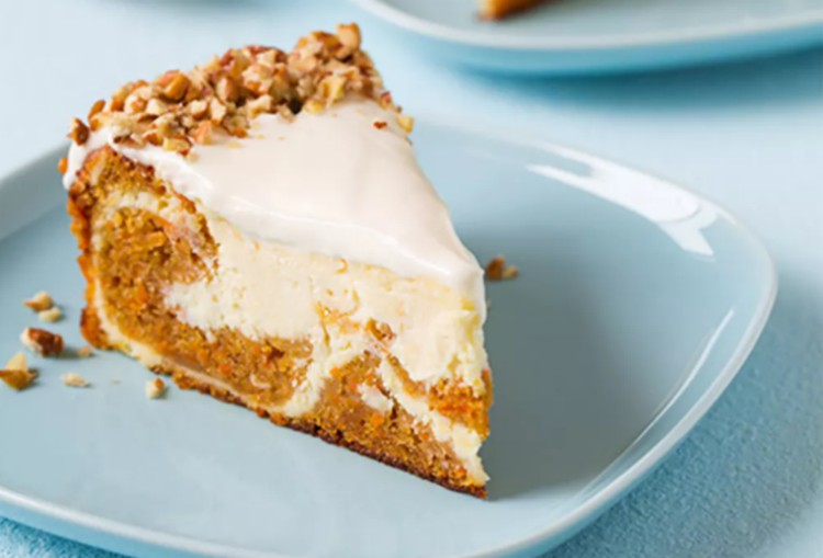 Image of a slice of carrot cheesecake.