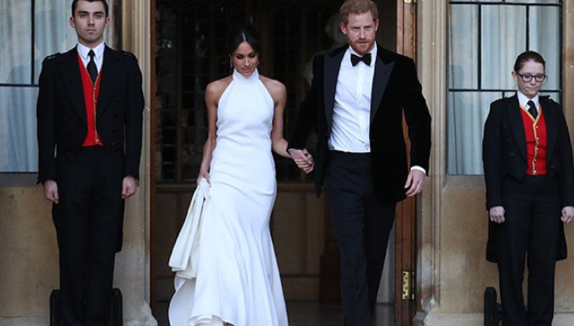 Image of Meghan Markle and Prince Harry exiting their reception