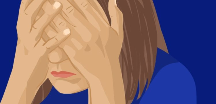 Image of depressed woman holding her face.