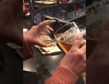 Image of man pouring beer into glass